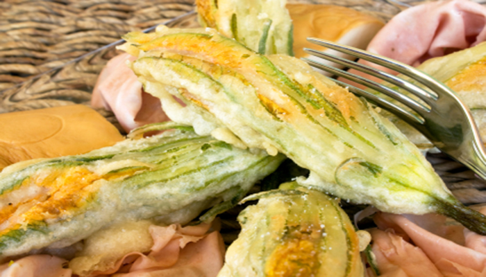 "Food And Drinks - Italian Appetizers - Closeup of plate with fried zucchini flowers, ""mortadella"" cold cut and ""scamorza"" cheese."