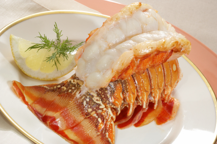 broiled Lobster tail elegantly plated prepared with butter and herbs